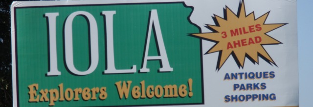 Iola's welcome sign north on hwy 169.
