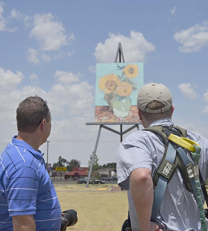 Tourist talks with artist Cameron Cross
