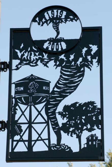 Unique metal street banners greet visitors on Main Street